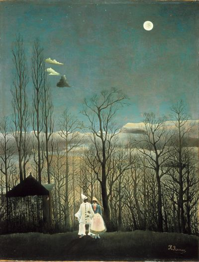 Two people dressed like clowns stand by a house by trees with a full moon in the sky with three clouds