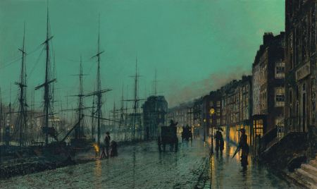 Ships anchored in port by a rain soaked city street at night