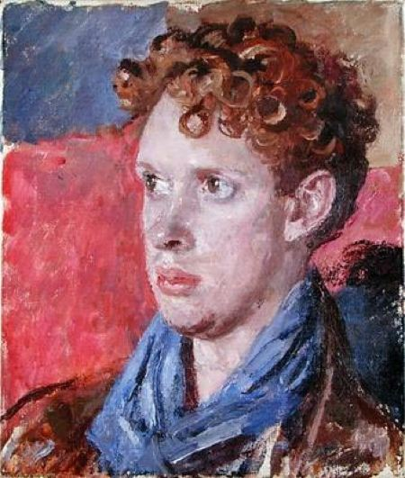 Portrait of a young man with a blue scarf