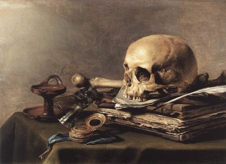 Still life painting with a skull on books with watch and quill