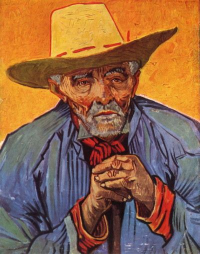 Portrait of a man with a hat with hands clasped together