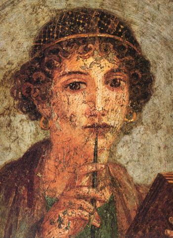 Portrait of a woman with a pen