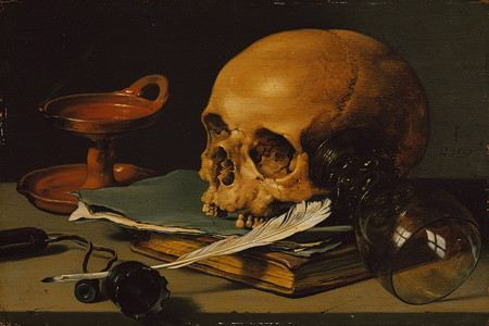 Painting of a skull resting on a book with ink and a quill