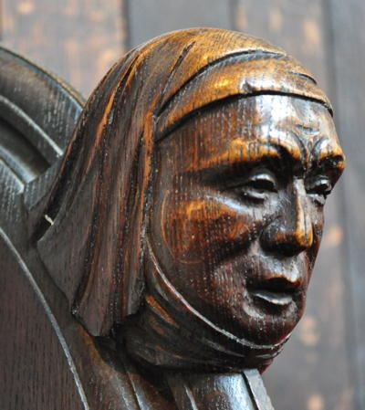 Wood carving of a woman's face
