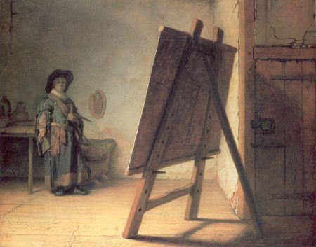 Painter in his studio looking over his work