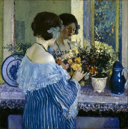 Girl looking at flowers on a mantlepiece in front of a mirror