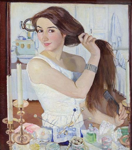 Woman brushing her hair in front of a mirror